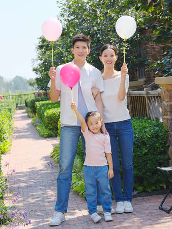 Happy family of three in the outdoor group photo high quality photo