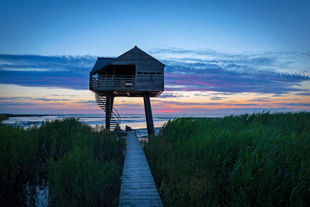 A wooden house for birdwatching on the border of Germany and Netherlands near Nieuwe Statenzijl Stock Photo