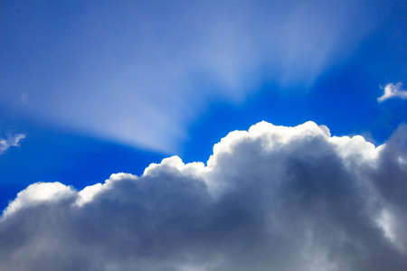 Sunlight shines through a cloud Stock Photo