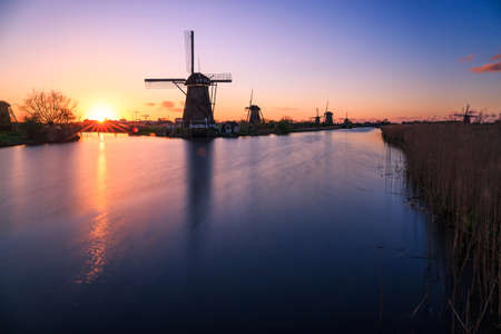 The name Kinderdijk is Dutch for Children dike. During the Saint Elizabeth flood of 1421, the Grote Hollandse Waard flooded, but the Alblasserwaard polder stayed unflooded. It is said that when the terrible storm had subsided, someone went to the dike b Stock Photo