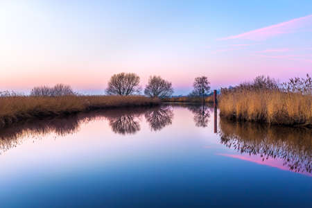 The river Leda near Potshausen in East Frisia at Sunset
