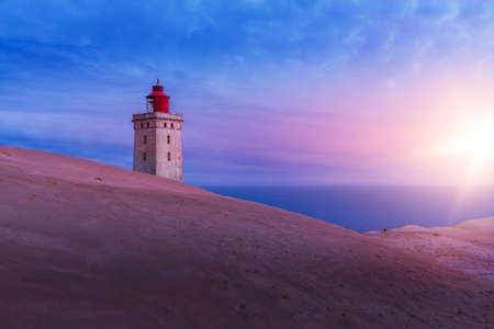 The lighthouse Rubjerg Knude in Denmark at sunrise Banco de Imagens