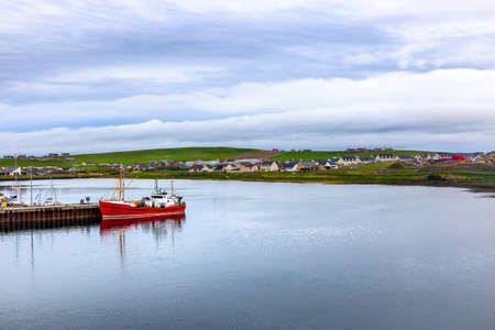 A ship in the harbor of Stromness