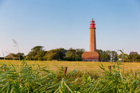 The lighthouse Fluegge (german Flügge) on a warm summer day on the german island Fehmarn.. It was build from 1914 to 1915.