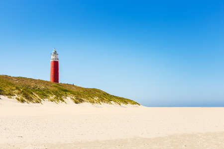 The lighthouse Eierland on the northernmost tip on the island Texel. It was built in 1864 and is nearly 35 metres high. 版權商用圖片