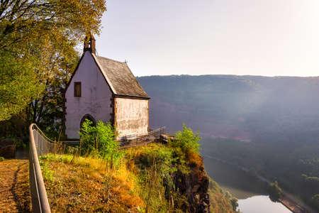 The St.-Michaels-Kapelle near Taben-Rodt over the river Saar 写真素材