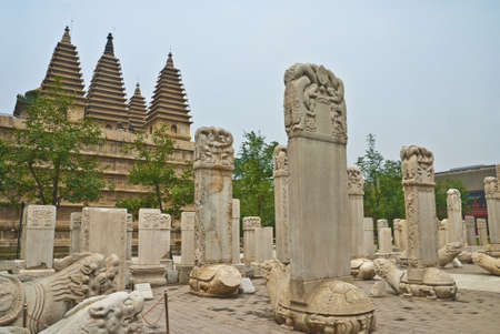 The stone tablet wood of five tower temples photo