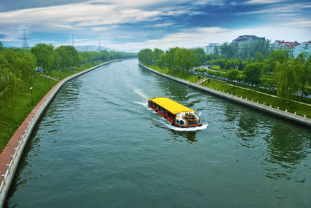 Cruise travel in a clean river Stock Photo
