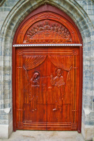Gothic church doorway with wooden doors and intricate metal