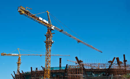 Busy construction site, crane movements Stock Photo - 7540009