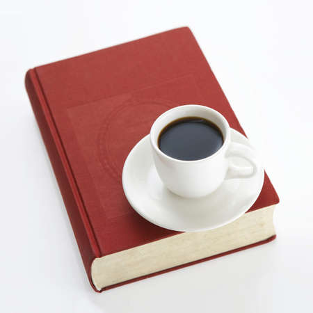A cup of coffee on the book