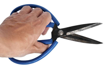 A hand holding scissors