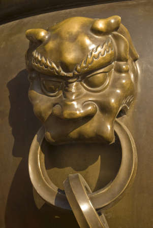 lion head door knob at Chinese temple