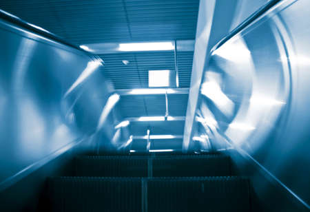 blur subway: the escalator of the subway station in beijing china.