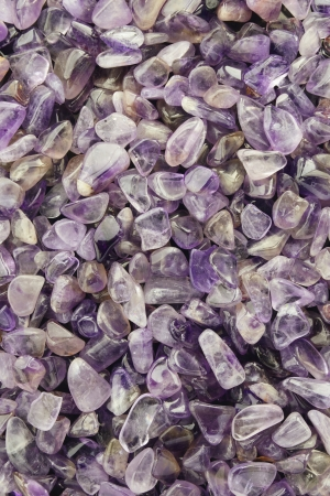 polished: Closeup background of polished Amethyst chips.