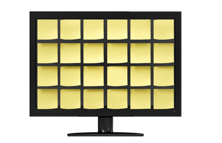 sleek: Sleek modern computer monitor covered in organized yellow notes in front of a white background. Stock Photo