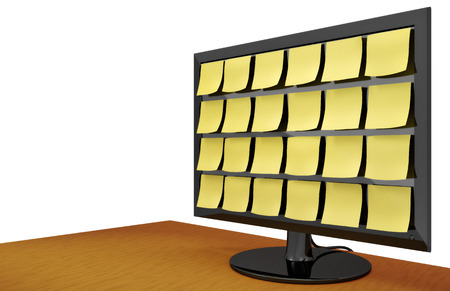 sleek: Modern sleek computer monitor covered with notes on a wooden desk. Stock Photo