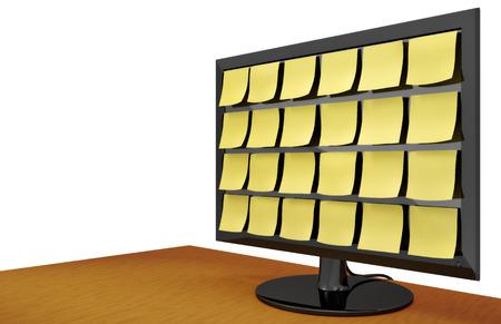 Moderne slanke computermonitor bedekt met noten op een houten bureau.