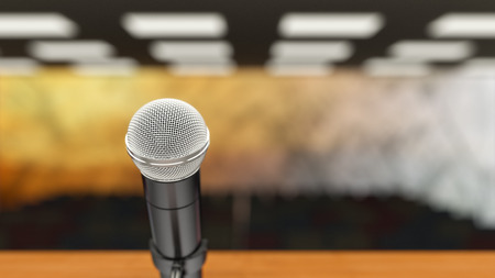 narrow depth of field: Closeup of microphone in lecture hall, narrow depth of field. Stock Photo