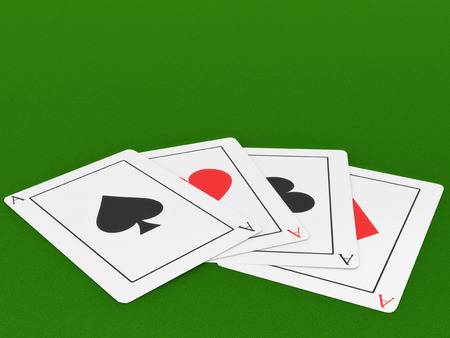 Four Ace playing cards on a felt green gaming table.