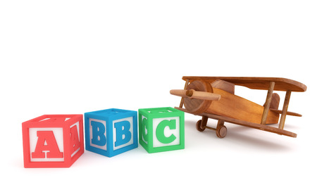 Wooden toy plane and learning blocks isolated on a white background. Banco de Imagens - 57296172
