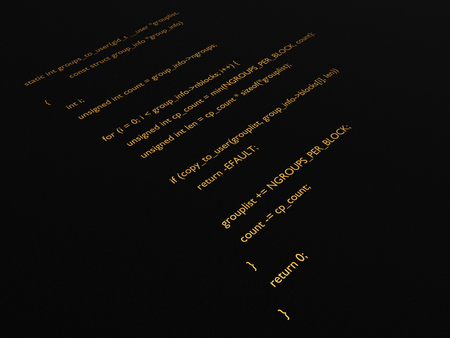 Printed gold computer programming code on a dark background.