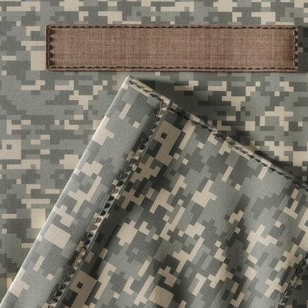Military uniform closeup of pocket and name badge. Banco de Imagens