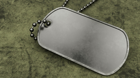 Blank military dogtag on a worn green military style cloth background.