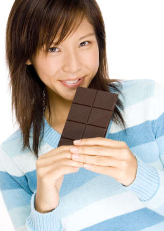 sinful: A cute smiling girl with a big bar of dark chocolate