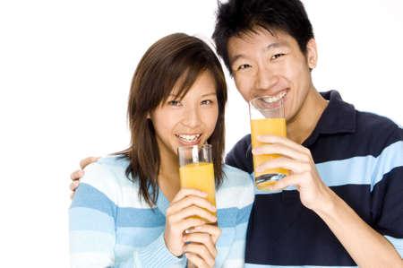 oj: A young couple drink OJ for breakfast