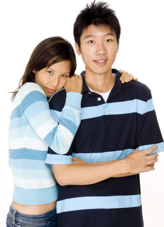A young asian couple in casual clothing on white background Stock Photo