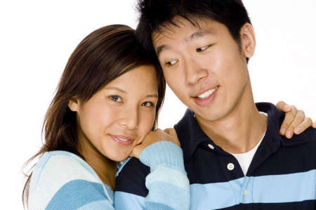 A young woman leaning on her mans shoulder photo