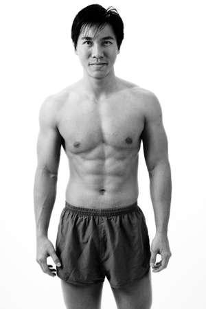 deltoids: A muscular asian man in running shorts
