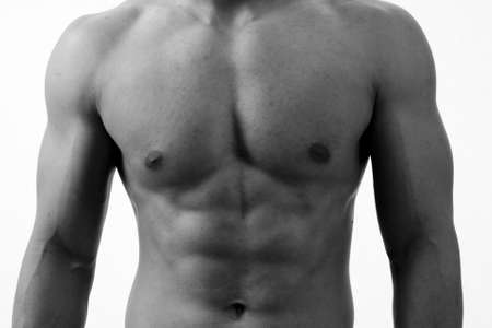 A monochrome shot of a muscular male torso Stock Photo