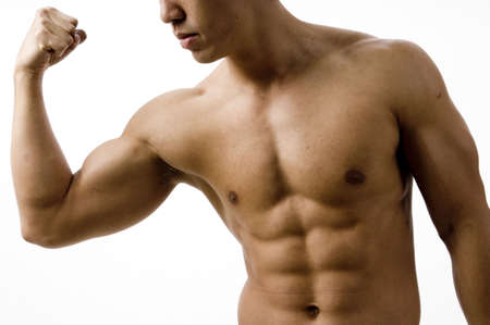 pectorals: A young man flexes his bicep Stock Photo