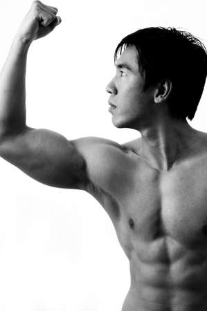 deltoids: A muscular male model posing in black and white