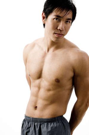 Los tonos cuerpo de un hombre joven chino  Foto de archivo - 408657