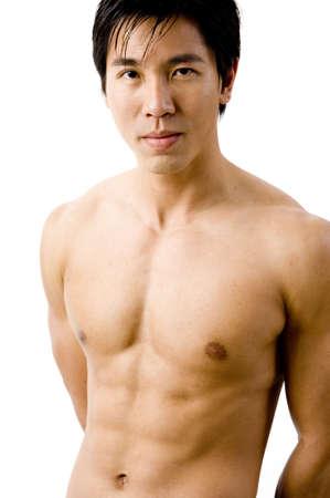 Un modelo masculino muscular chino sobre fondo blanco  Foto de archivo - 408651