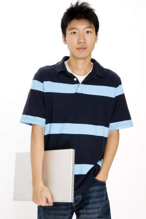 bloke: A young asian male with a laptop computer Stock Photo