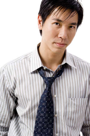 undone: A young asian businessman with tie slightly undone