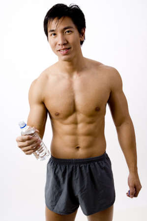 A well-built young asian male holding a bottle of water Stock Photo - 411010