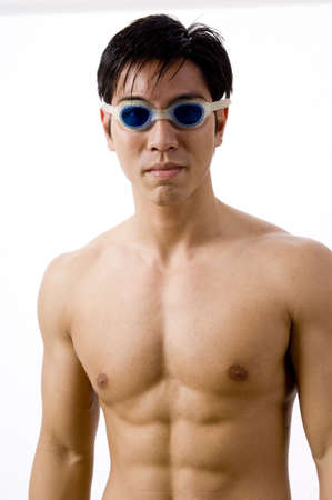 A young male swimmer in goggles photo