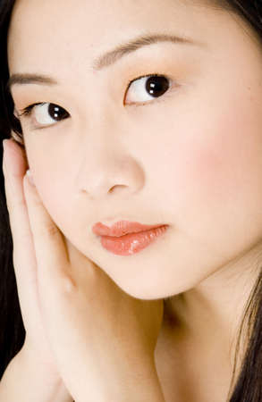 A beautiful young asian woman resting head on hands photo