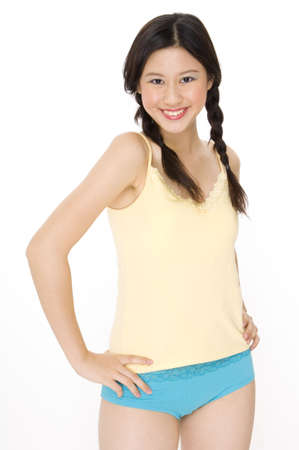 A young asian woman in yellow and blue Stock Photo