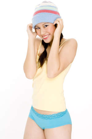 A happy youthful woman in a hat and colorful clothing photo
