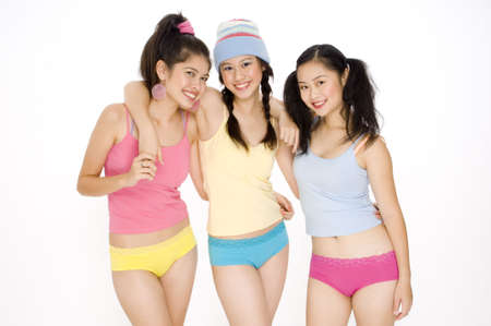 teen underwear: Three young asian women in colorful outfits Stock Photo