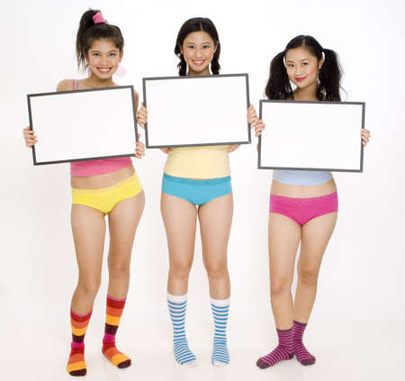 Three pretty asian girls holding blank signs photo