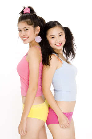 Two pretty teenage woman in colorful underwear photo