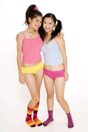 Two young women in colorful clothes photo