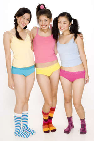 Three pretty young asian women in colorful underwear and socks photo